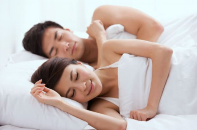 naked sleeping couple