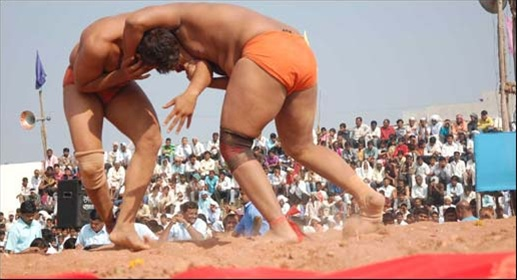 Shailesh from India wins wrestling match held in Nawalparasi