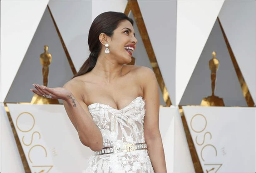 Presenter Priyanka Chopra poses as she arrives at the 88th Academy Awards in Hollywood, California February 28, 2016. REUTERS/Lucy Nicholson