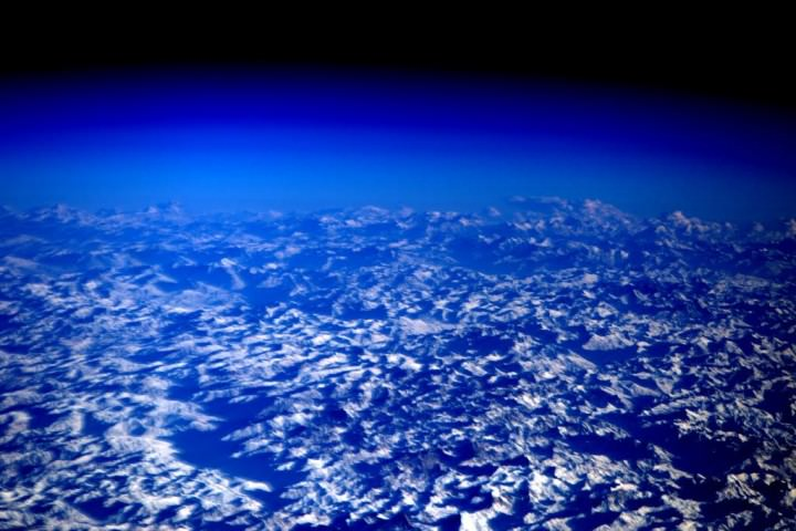 Hazy blue scene of himalayas from space